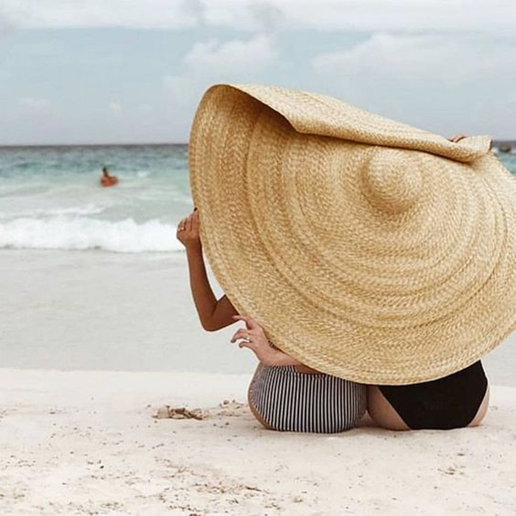 Go big with an extra wide sun hat to add a touch of fun to your holiday.